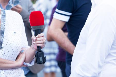 Journalist making media interview