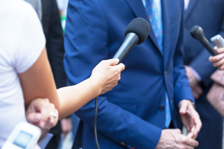 Journalists making press interview with business person or politician 写真素材