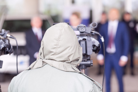 Cameraman working at news conference