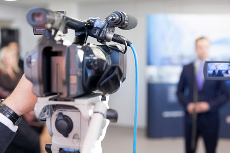 Filming media event with a television camera