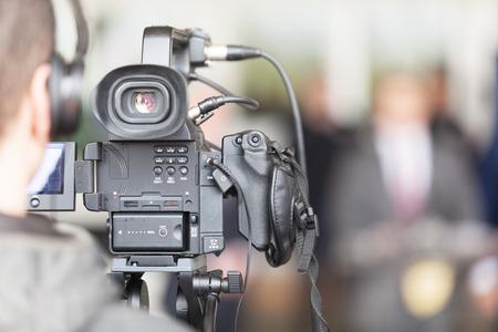 Cameraman working at press conference 写真素材