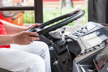 Close up of bus driver driving bus