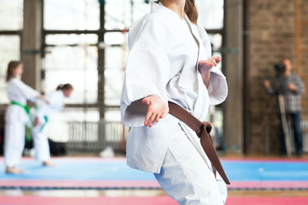 Karate brown belt practitioner body position during competition