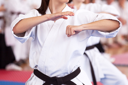 Female karate black belt practitioner body position during class