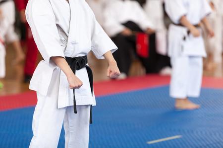 Karate black belt practitioner body position during competition