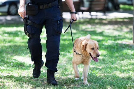 Policeman with police dog on duty