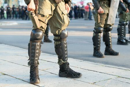 Armed riot police on duty during street protest