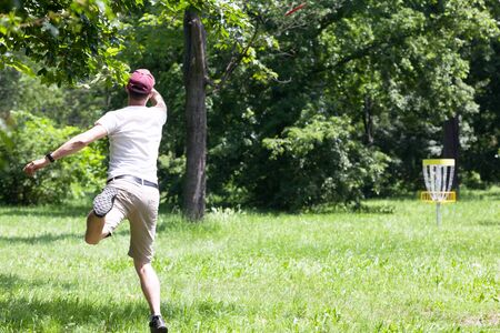 Man playing disc golf in the park