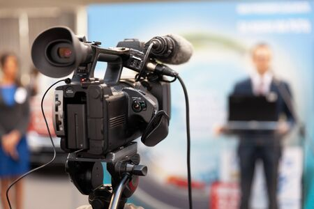 Filming news or press conference with a video camera