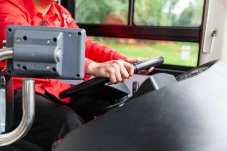 Public transit bus driver at work Фото со стока