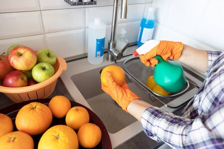Spraying disinfecting chemical on the fruit in the kitchen