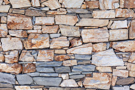 Rustic stone wall texture or background