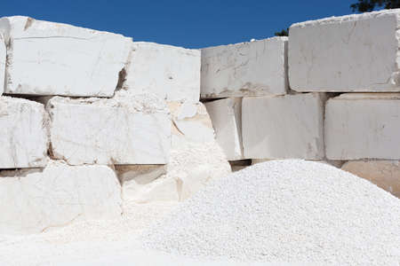 Big white blocks of raw marble from a quarry
