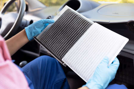 Replacing the cabin pollen air filter for a car 版權商用圖片