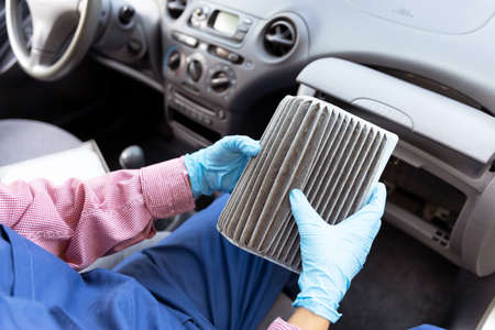 Replacement of dirty cabin pollen air filter for a car 版權商用圖片