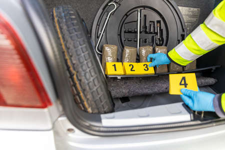 Police seize drug in the trunk of a vehicle during traffic stop