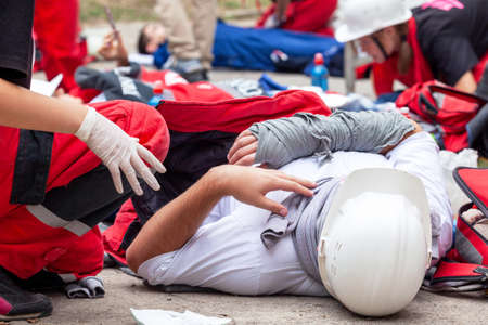 Workplace or work accident at construction site. First aid training.