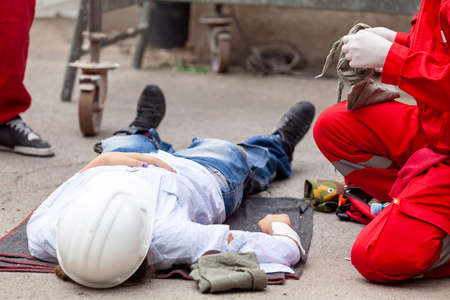 Work accident or workplace accident at construction site. First aid and CPR training.
