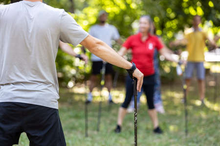 Nordic or pole walking warm up in the nature