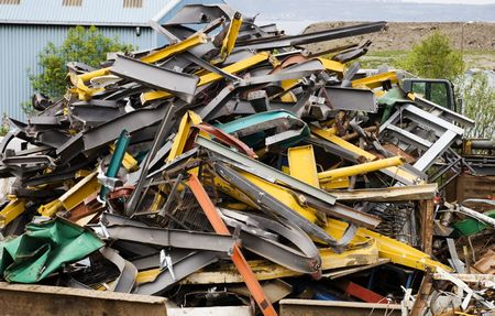 discarded metal: Container of brightly-coloured scrap metal. Stock Photo