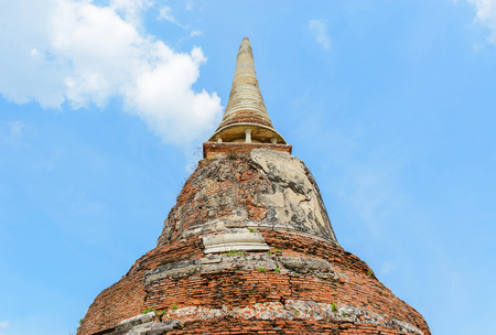Ancient buddha statue at Wat Mahathat Buddhist temple, historic site in Ayutthaya, Thailand.