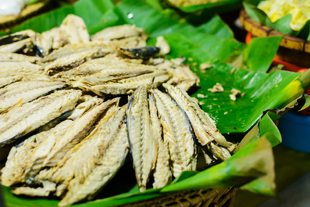 Mackerel fishes in banana leaf for sale in local market. thailand Stock Photo