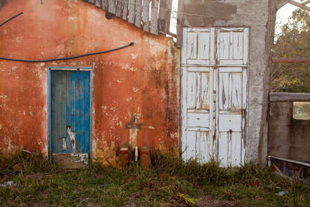 Old colored door in abandoned house in countryside Imagens