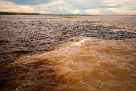 Different colors water meeting - Black and Solimoes river - Manaus - Amazon