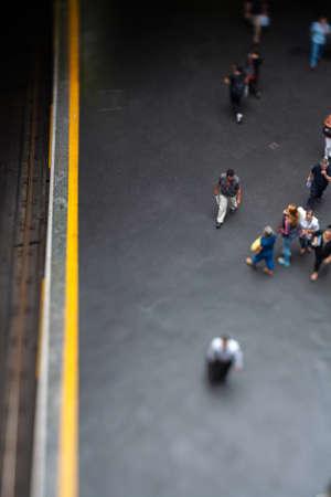 Mockup model style urban landscape - people on subway train platform - real tilt-shift TS lens
