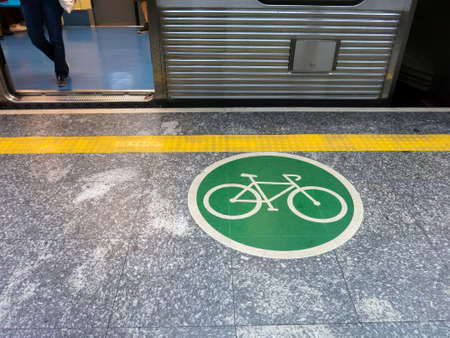 SAO PAULO, BRAZIL - APR 14, 2018 - Adhesive plate on the ground indicating bicycle access area in brazilian subway