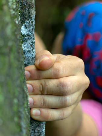 Rock climber hand closeup detail holding climbing