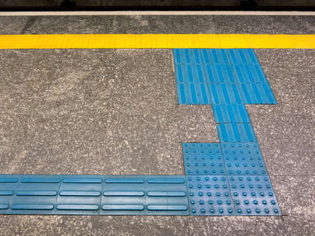 Tactile Ground Surface Indicators for visually impaired in brazilian subway station Reklamní fotografie