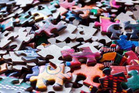 Disassembled puzzle colored pieces Foto de archivo