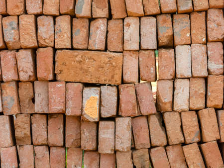 Stacked used clay brick for reuse