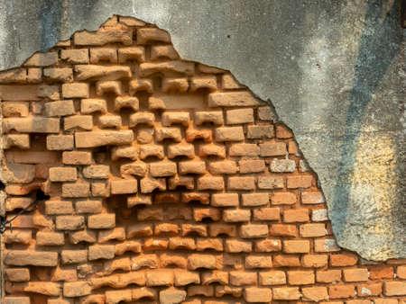 Old damaged abandoned brick wall