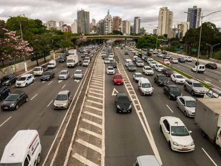SAO PAULO, BRAZIL - OCT 04, 2018 - Car Traffic on 23 de Maio and Pedro Alvares Cabral avenues in front of Ibirapuera park in a cloudy day Editorial