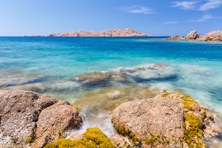 derives: Isola Rossa (Red Island) is a very nice village which overlooks the Gulf of Asinara. Its name derives from the little rocky red island situated in front of the city