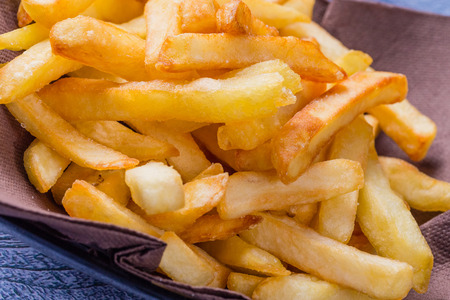 fattening: Potatoes Chips, French Fries Background, Close Up Potato Chips, French Fries Background, Close Up Stock Photo