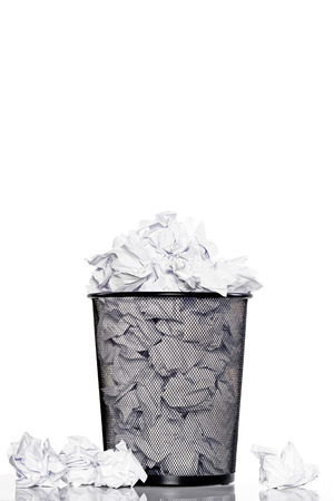 trashed: A trashcan full of crumpled paper