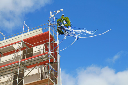Topping-out wreath of a roofing ceremony 스톡 콘텐츠