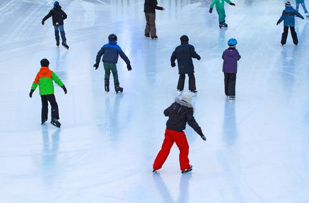 People entering ice rink on skates Stock Photo