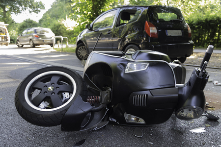 road accident with black engine scooter