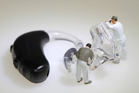 Adapting the ear tip of a hearing aid Stock Photo