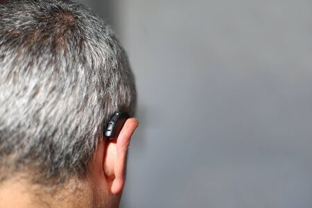 Black hearing aid behind the ear Zdjęcie Seryjne