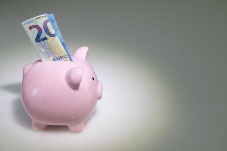 20 euro note in a piggy bank