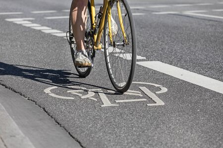 Cyclist on painted bicycle lane