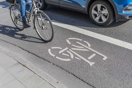 car beneath cyclist on bike lane 版權商用圖片