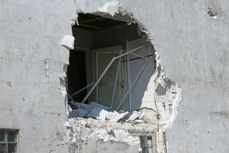 large hole in the wall of residential building