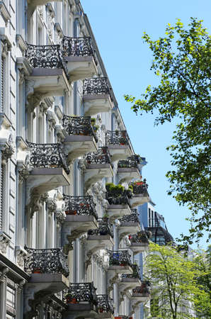 Old residential building with balconies in springtime