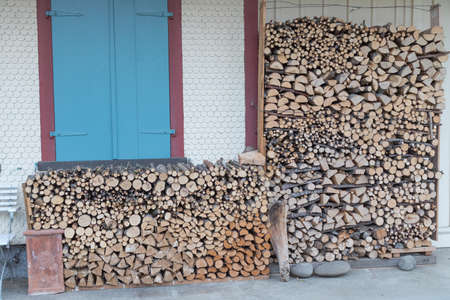 stacked firewood on traditional woodhouse in Germany